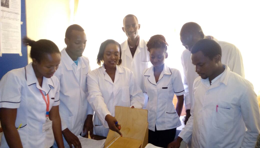 Ruth Mbugua, Head of Department Community Health Nursing demonstrating to Bachelor of Science Nursing students on use of an Infantometer during growth monitoring.
